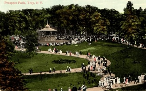 Turn of the century strollers in Troy's Prospect Park admire the gardens, bandstand and paths