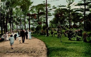 People in Victorian dress walking in Prospect Park in the early 1900s